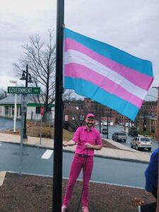 Emmett Soldati raising the Trans flag
